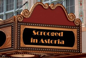 """red and gold theater marquee with white lights advertising """"Scrooged in Astoria"""""""