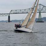 Sailboat in front of Astoria-Megler Bridge
