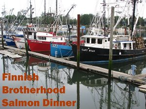 Row of red and white, blue and white fishing boats anchored at narrow pier. Text: Finnish Brotherhood Salmon Dinner