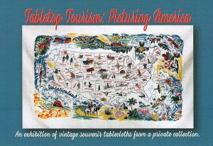 Histiruc tablecloth map of US with different pictographs for attractions. Red text on blue border: Tabletop Tourism Picturing America