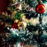 Holiday wreath on green door by Rodion Kutsaev on UnSplash https://unsplash.com/@frostroomhead