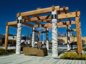 Garden of the Surging Waves Pavilion with carved white columns and wood beams on plaza by Michelle Roth Photography