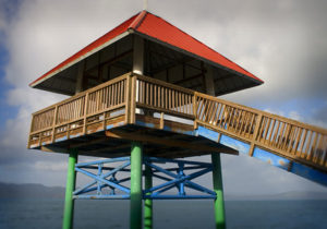 Columbia River viewing tower with brown wooden railings, green tower, &  red roof by Michelle Roth Photography