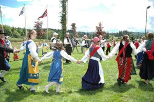 ring dancers in Scandinavian costumes at Astoria Midsummer Festival